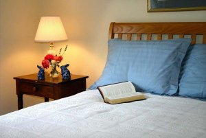 Open book on a bed