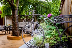 Small metal garden decoration next to flowers