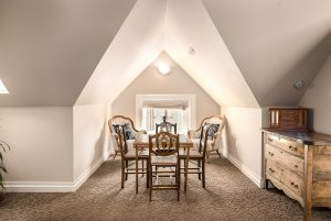 Chairs around small table under vaulted ceiling