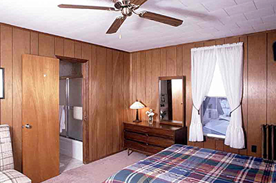 Room with ceiling fan and panelling in the Weyside Inn in the Catskills near Belleayre Mountain