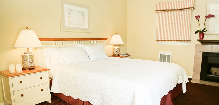 Standard King Room with bed, end tables and lamps at White Water Inn in Cambria, CA