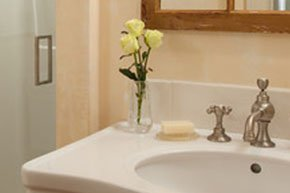 Pretty yellow roses on the bathroom sink at Simeon Potter House