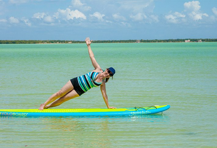 paddleboard yoga at crimson orchid