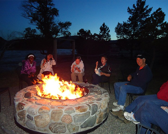 People gathered around a campfire in a firepit