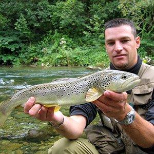 fisherman showing big fish