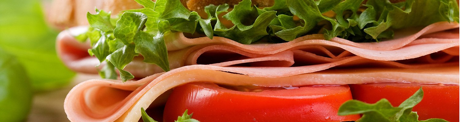 A sandwich made with sliced meat