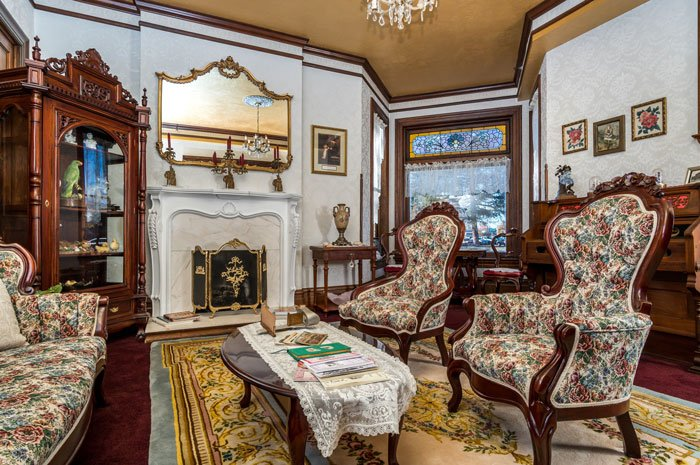 Antique fireplace and furniture in the formal living room