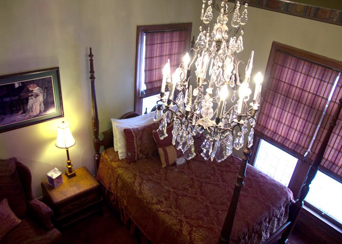 Library Room bed and chandelier in Hines Mansion in Provo, UT