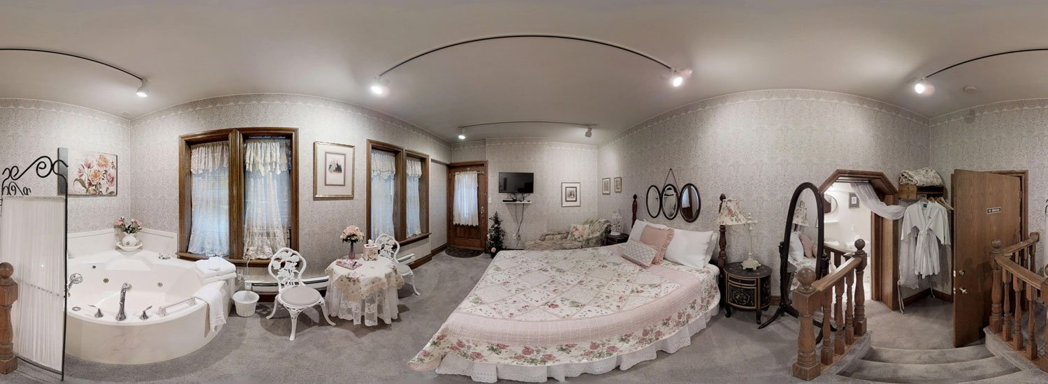 Victorian Rose room with bed and jetted tub