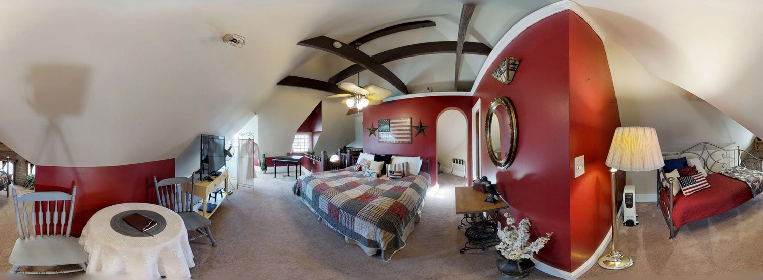 Eagles Nest Room with beds and table