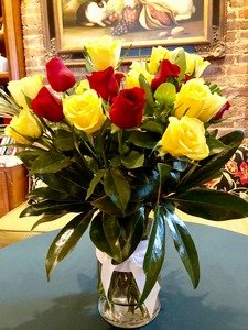 A dozen yellow and red roses