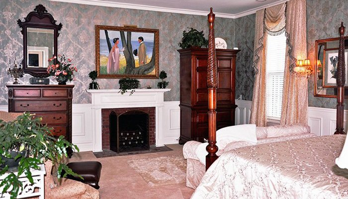 Fireplace and four post bed in the Somewhere In Time