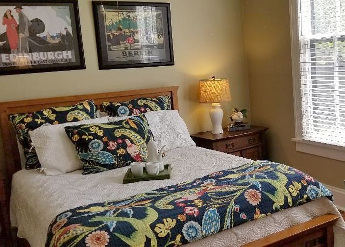 A bed with vibrant floral covers