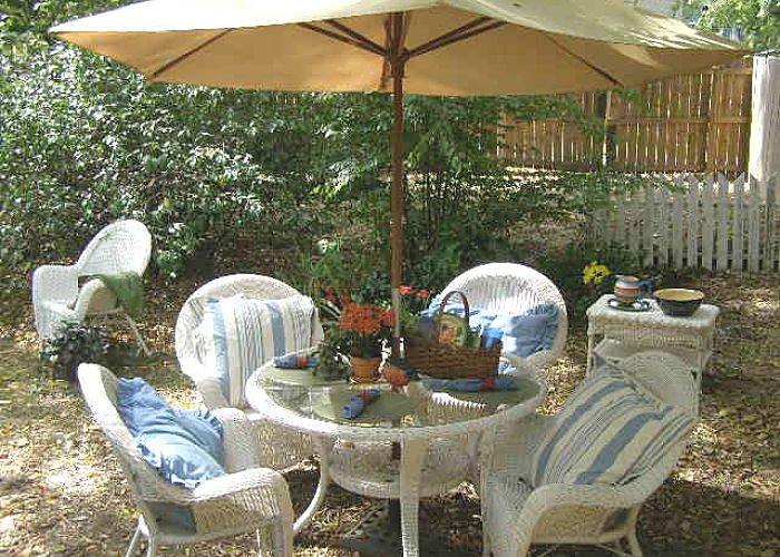 An outdoor table with sun umbrella