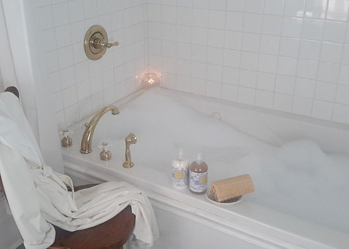 A bathtub filled with bubbles