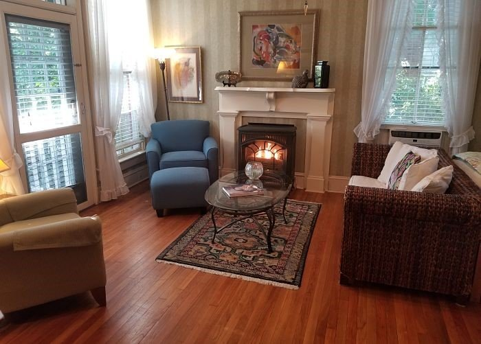 A sitting area with fire place