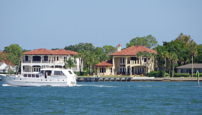 A boat in front of houses