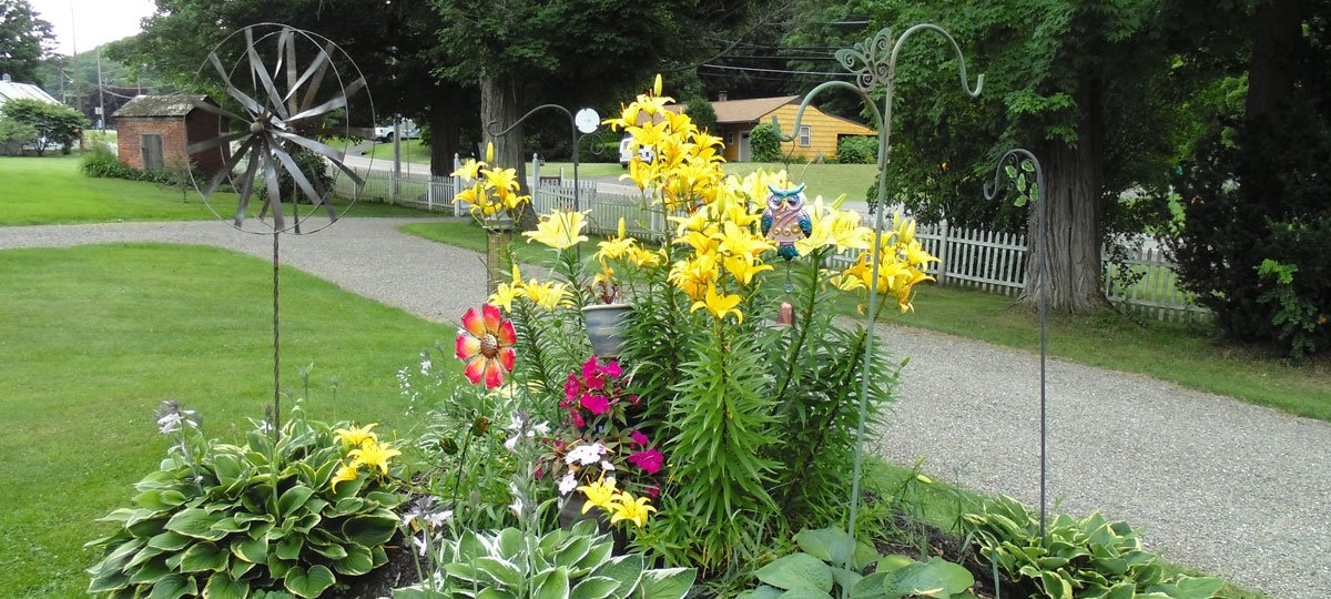 A flowerbed with a windmill decoration