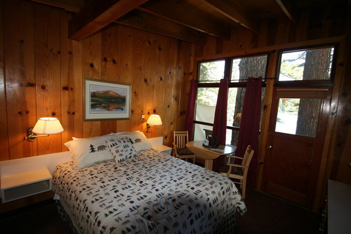 A bed in a cabin bedroom