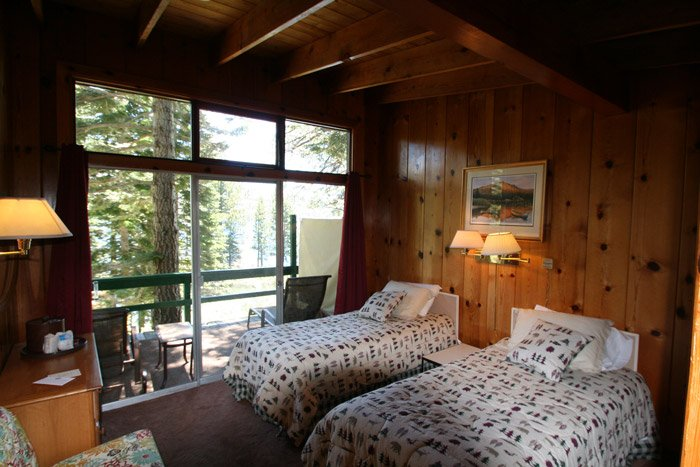 Two beds in a cabin bedroom
