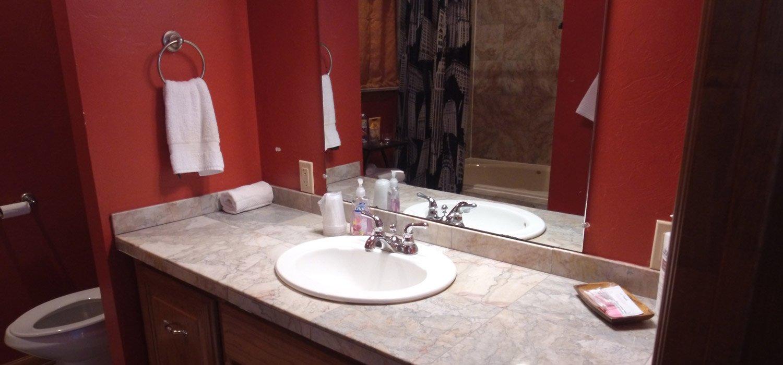 Sterling suite norman ok whispering pines inn for Bathroom remodel norman ok