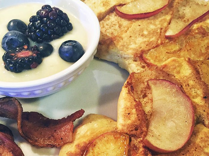 german pancakes with apples and yogurt and berries