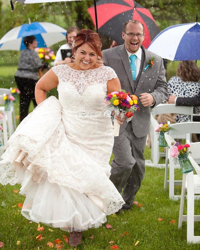 Couple running down the aisle after being married