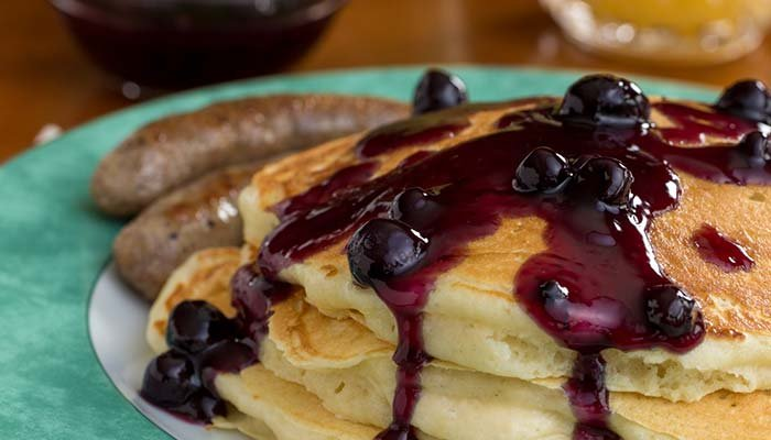 Buttermilk pancakes topped with blueberry compots