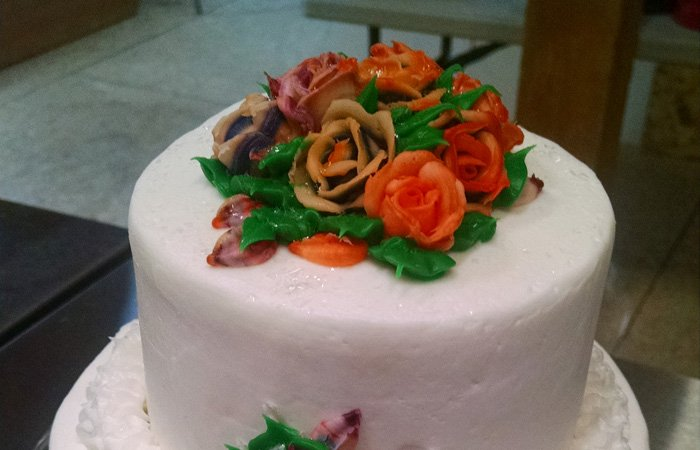 Small 2-tier wedding cake decorated with buttercream roses