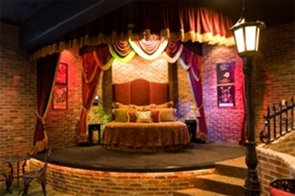 Bed on a stage in a theater themed room