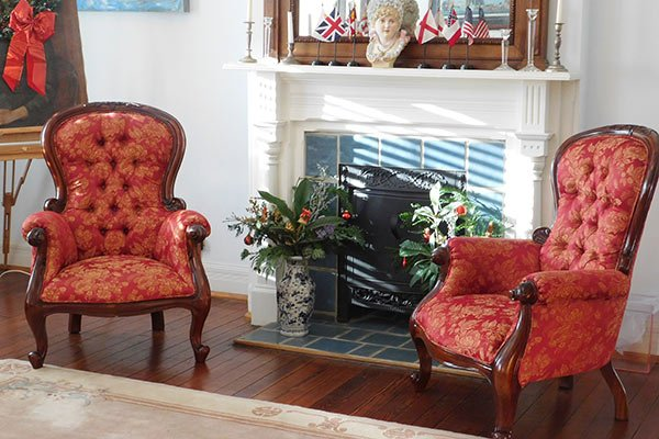 Two armchairs near a fireplace