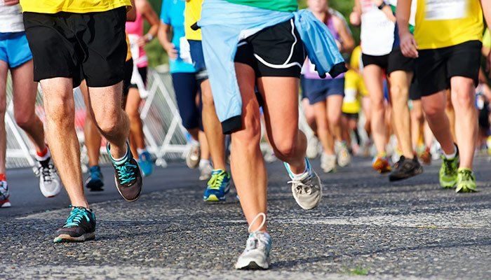 People running a road race