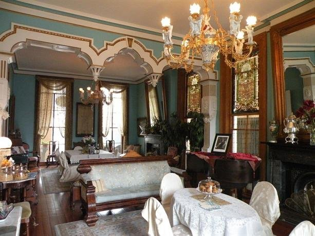 parlor with chandelier and period furniture