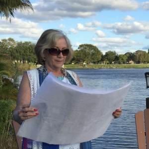 Patricia Detwiler examining blueprints