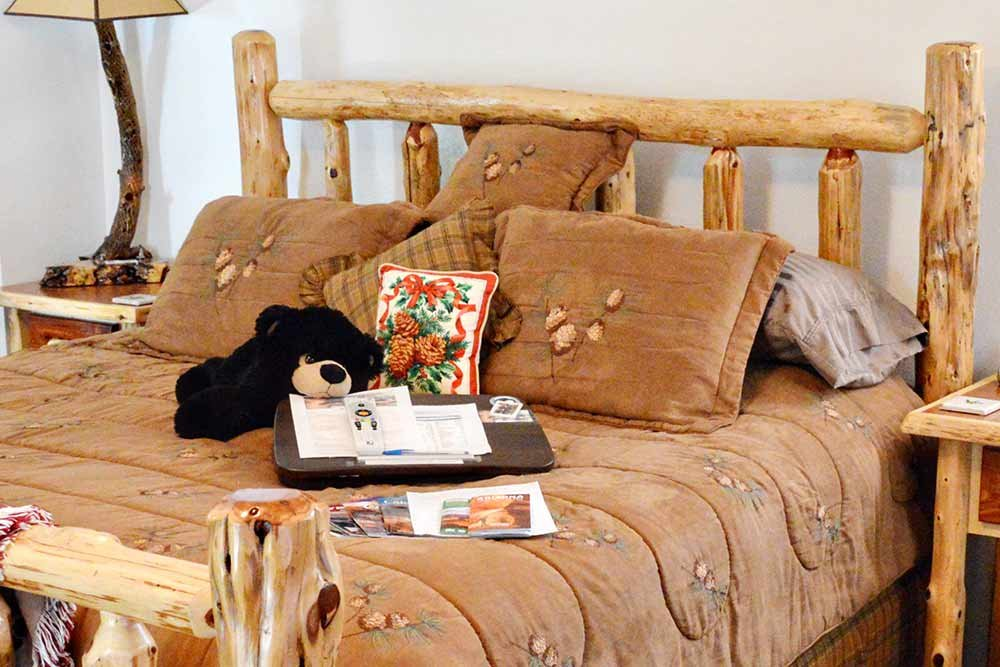 Bed made from carved logs