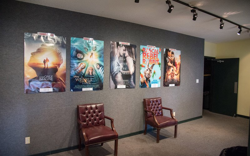 Chairs adjacent to a wall with movie posters