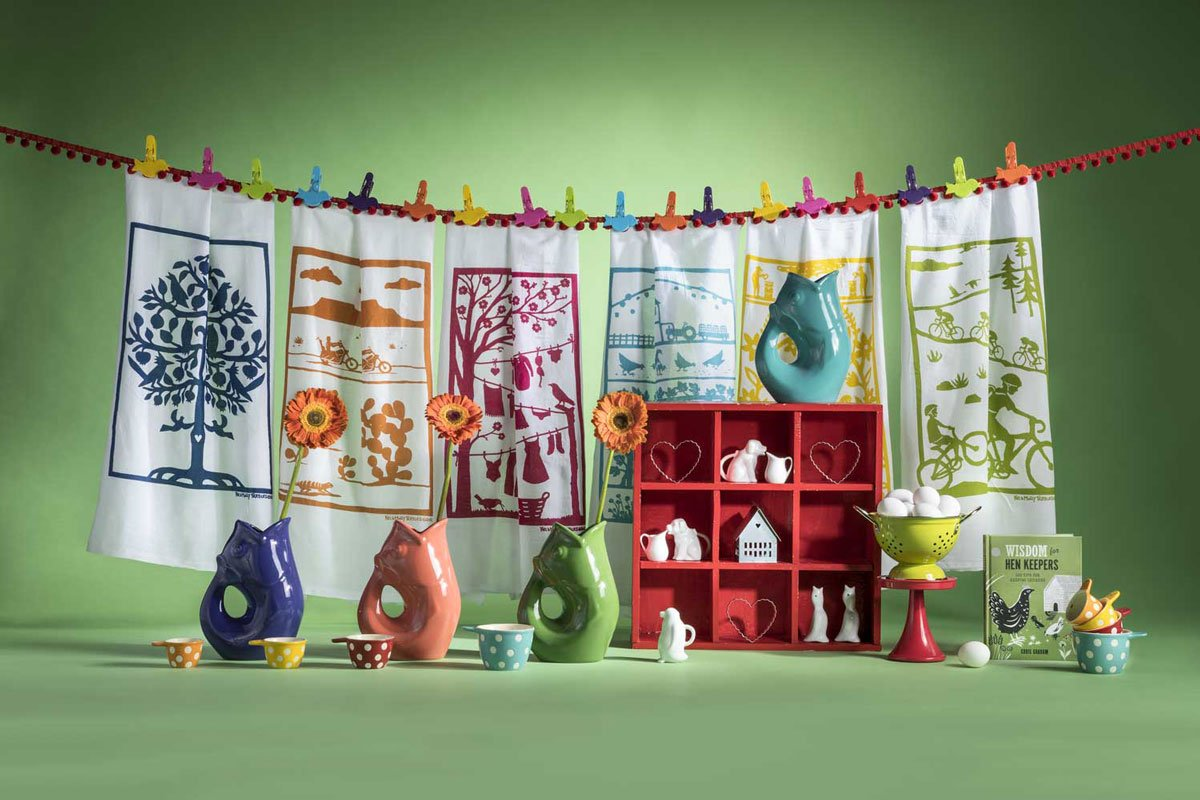 handcloths hanging, fish vases, red shelf with trinkets