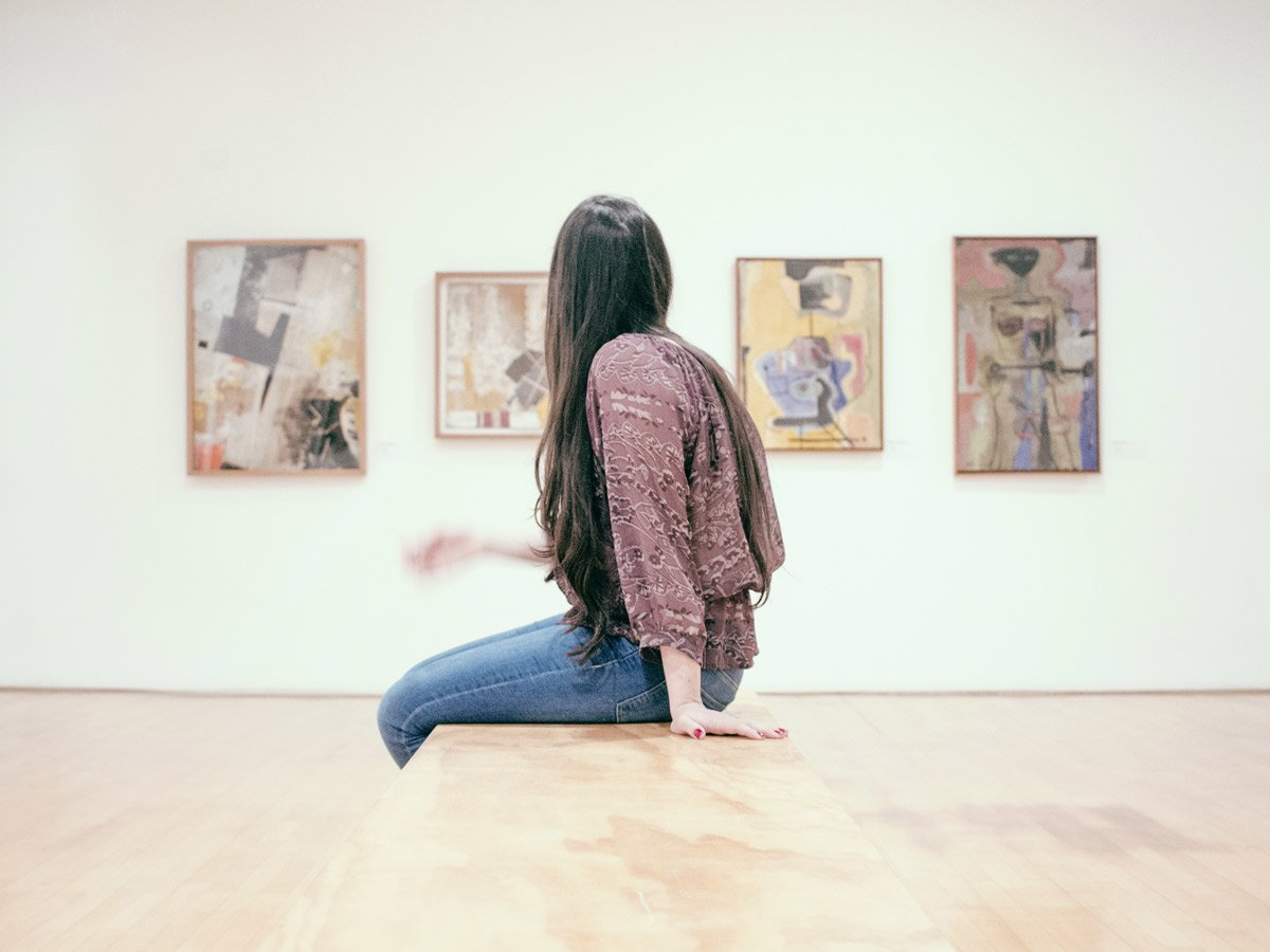 woman sitting at an art gallery