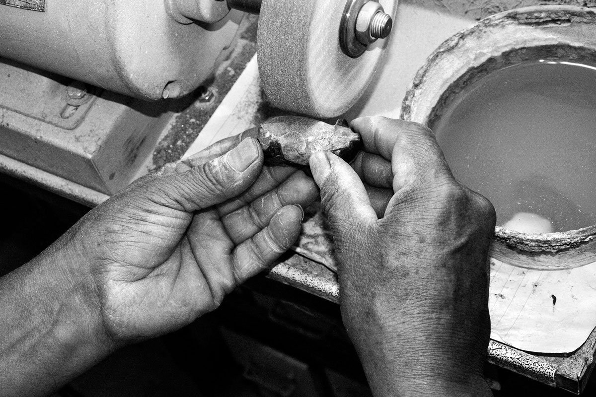 artisan's hands at the grinder