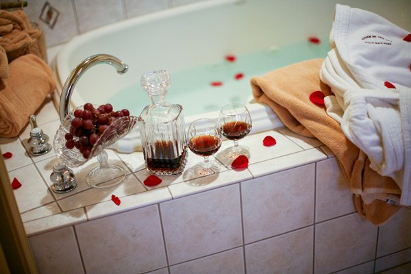 Haven by the Sea bathtub wine grapes rose petals