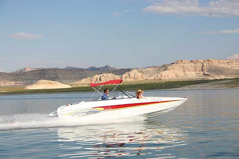 boat speeding across Lake Powell