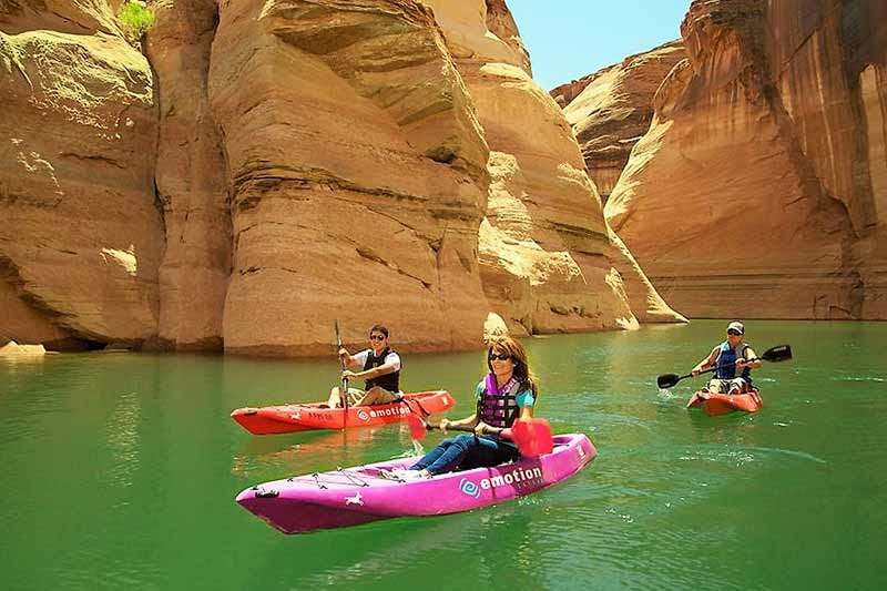 three kayakers in Hidden Canyon