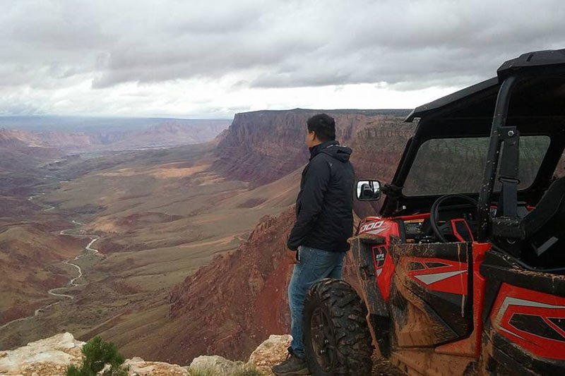 man next to utv overlooking a canyon