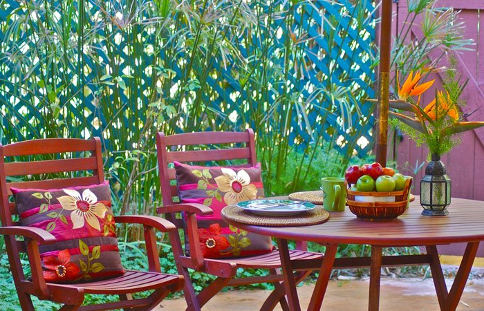 Colorful patio with chairs and table