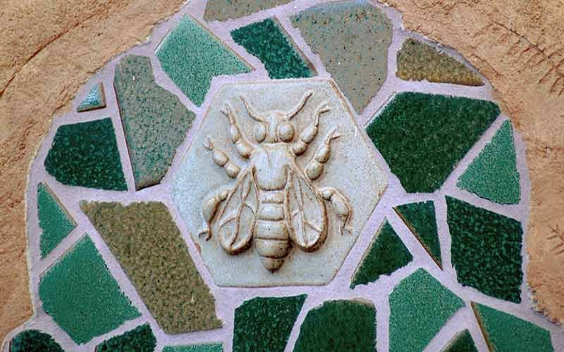 A relief of a bee in the center of a mosaic