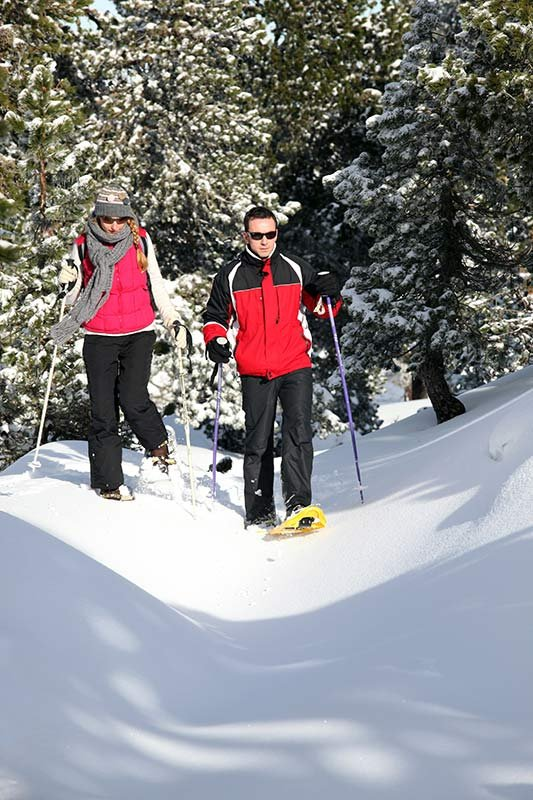 man and woman snowshoeing