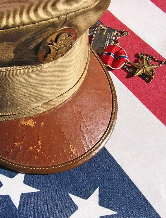 military hat on flag