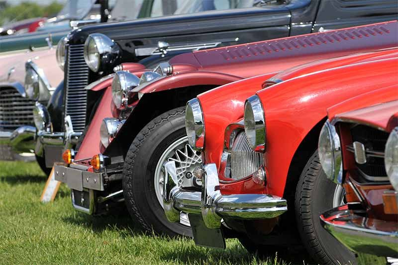 row of vintage cars at car show