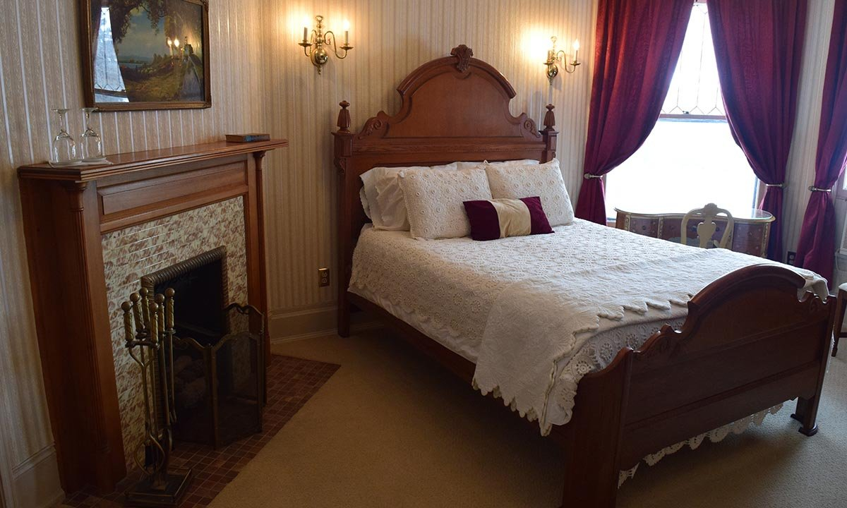 bed and fireplace in the Crosby Room