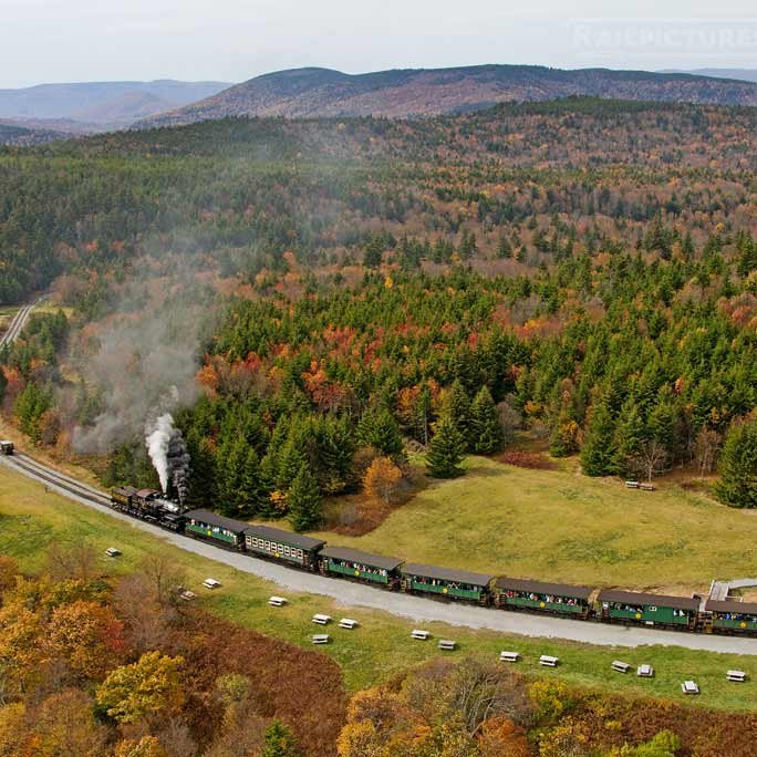 steam train circling forest